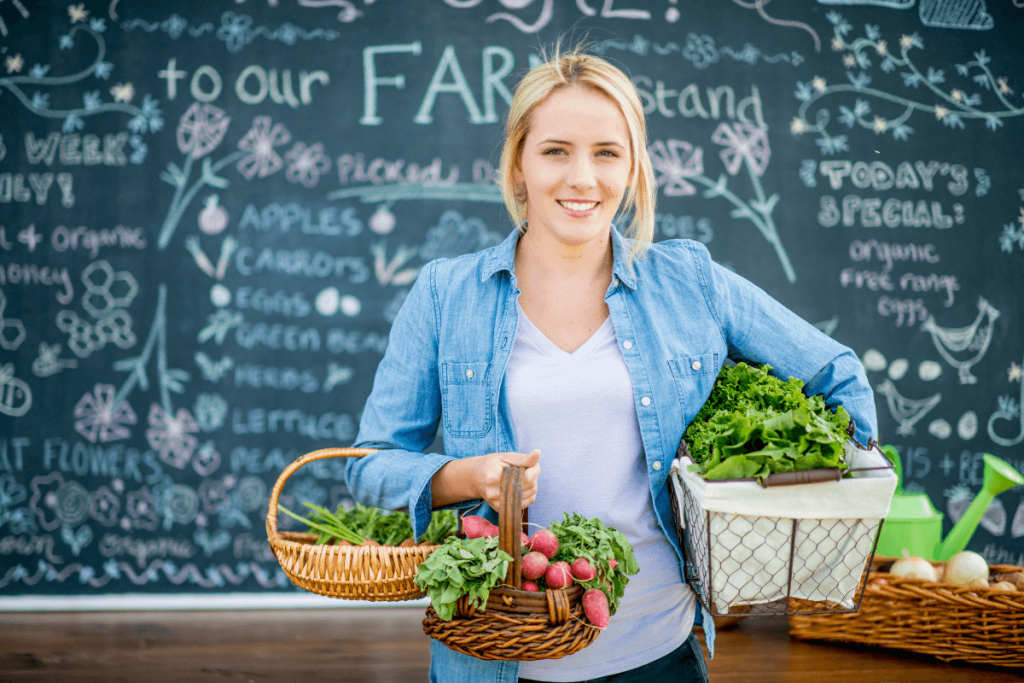 Woman with vegetable baskets - photo by FatCamera Getty Images Signature